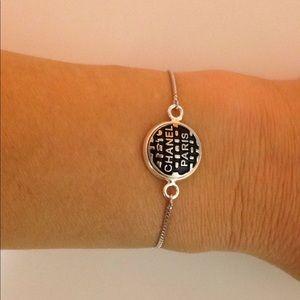 Slider bracelet with repurposed button